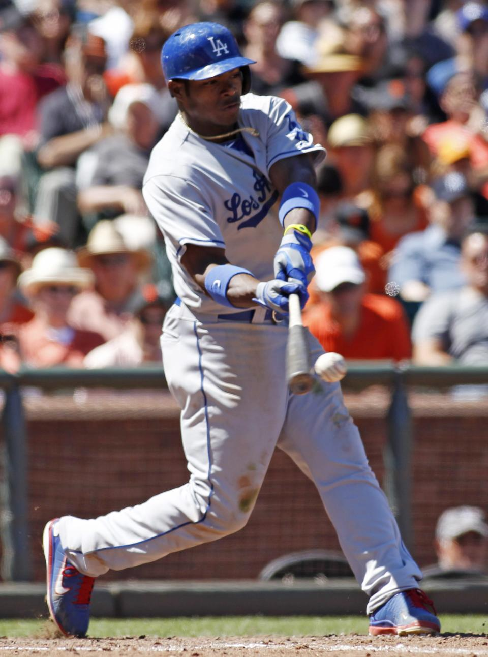 Los Angeles Dodgers' Yasiel Puig hits a single against the San Francisco Giants during the ninth inning of a baseball game in San Francisco, Sunday, July 7, 2013. The Dodgers beat the Giants 4-1. (AP Photo/George Nikitin)
