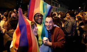 Revelers dressed in rainbow costumes celebrate the success of Washington state's referendum legalizing gay marriage.