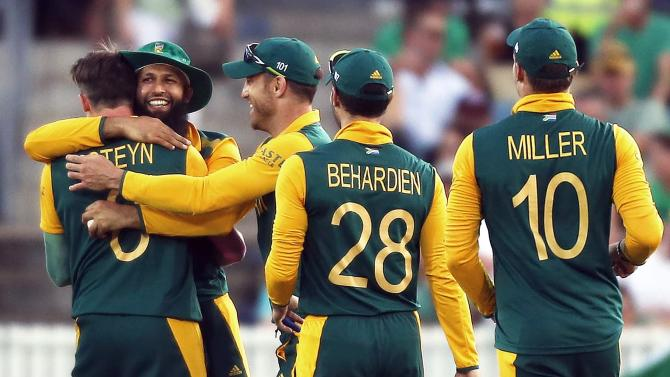 South Africa's Hashim Amla celebrates with teammates after catching Ireland's Ed Joyce out for a duck during their Cricket World Cup match at Manuka Oval in Canberra