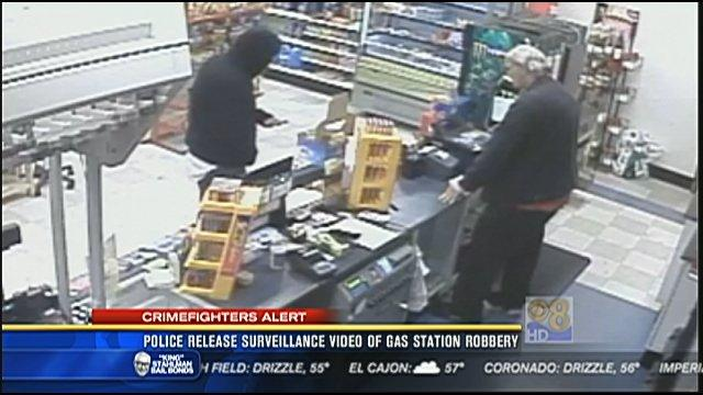 Police release surveillance video of gas station robbery