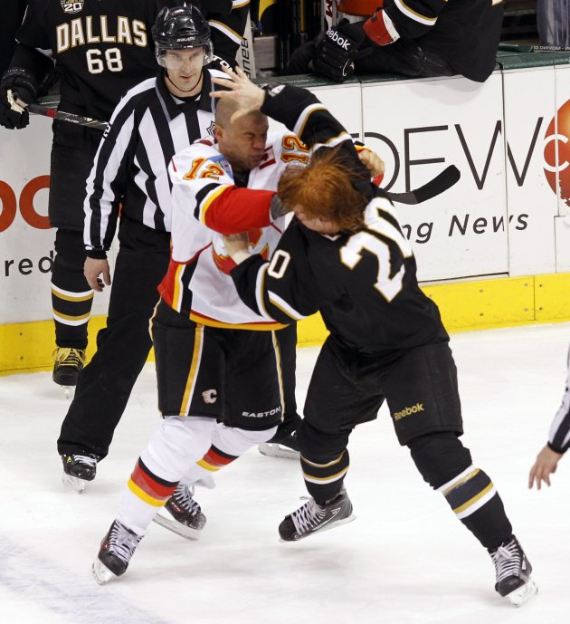 Calgary Flames' Iginla and Dallas Stars' Eakin fight during their NHL hockey game in Dallas