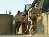 <p>Picture taken on November 3, 2012 shows Britain's Prince Harry (R) running out of the VHR (very high ready-ness) tent to scramble his Apache with fellow pilots at Camp Bastion in Afghanistan's Helmand Province. Harry said he killed Taliban fighters during his stint as a helicopter gunner in Afghanistan, in comments that can be reported after he completed his tour of duty Monday</p>