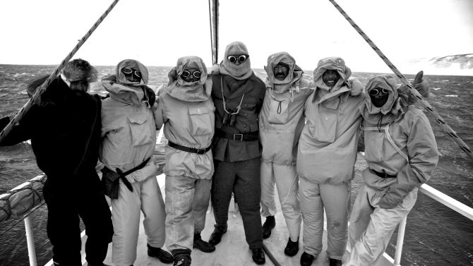 In this Jan. 8, 2013 photo released by Shackleton Epic, expedition members and an unidentified supporter pose on the deck of their boat Alexander Shackleton during training in the Southern Ocean. A modern-day team of six led by Tim Jarvis and Barry Gray used similar equipment and clothes to a re-enacted a 1916 expedition of  led by Ernest Shackleton to save his crew after their ship got stuck in Antarctica's icy waters. In honor of the epic journey the team sailed 800 nautical miles on the Southern Ocean in a small lifeboat and then climbed over crevasse-filled mountains in South Georgia to complete the historic journey. (AP Photo/Shackleton Epic, Alex Kumar)