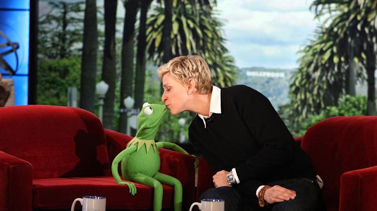 "FILE - In this Nov. 8, 2011 file photo provided by Warner Bros., talk show host Ellen DeGeneres kisses Kermit The Frog on ""The Ellen DeGeneres Show"" in Burbank, Calif. Show producers and NBC announced Monday, March 11, 2013 that ""The Ellen DeGeneres Show"" has been renewed through 2017. (AP Photo/Warner Bros. Television, Michael Rozman, File)"