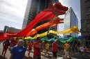Participants march with rainbow-colored dragons in a gay pride parade in Salt Lake City