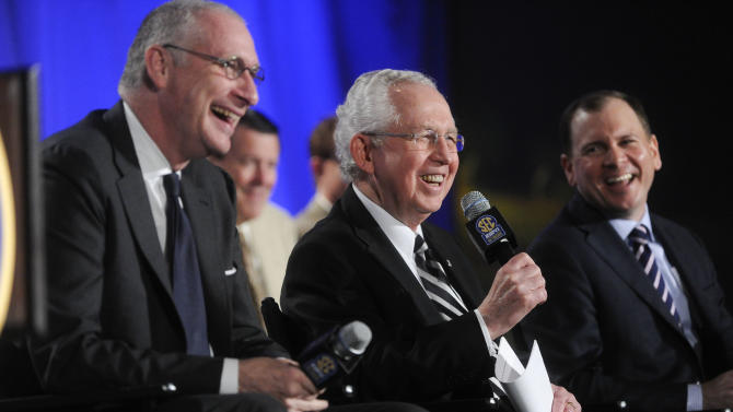 Southeastern Conference Commissioner Mike Slive, center, ESPN President John Skipper, left, and ESPN Senior Vice President, Programming, Justin Connolly agrees the media during a news conference announcing the launching of the Southeastern Conference Network in partnership with ESPN, Thursday, May 2, 2013, in Atlanta. The network will produce 1,000 live events each year, including 450 televised on the network and 550 distributed digitally. (AP Photo/John Amis)