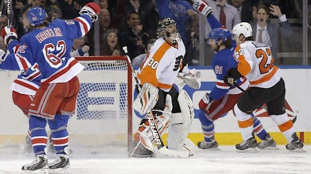 New York Rangers left wing Rick Nash (61) skates past Philadelphia Flyers goalie Ilya Bryzgalov (30) and defenseman Luke Schenn (22) after he scored at Madison Square Garden (Reuters)