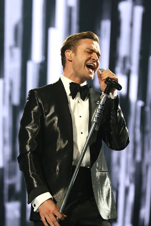 "FILE - In this Feb. 20, 2013 file photo, Justin Timberlake performs on stage during the BRIT Awards 2013 at the o2 Arena in London. Timberlake will hit the road with Jay-Z for the ""Legends of the Summ"
