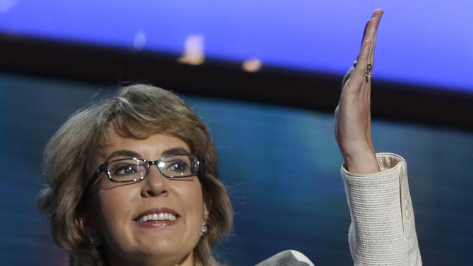 FILE - In this Sept. 6, 2012 file photo, former Arizona Rep. Gabrielle Giffords blows a kiss after reciting the Pledge of Allegiance at the Democratic National Convention in Charlotte, N.C. A judge has lifted his order that prevented the release of investigation records in the Tucson shooting rampage that killed six people and wounded former U.S. Rep. Gabrielle Giffords two years ago. (AP Photo/Charles Dharapak, File)