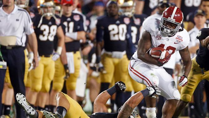 Alabama's Eddie Lacy tries to get past Notre Dame's Manti Te'o during the first half of the BCS National Championship college football game Monday, Jan. 7, 2013, in Miami. (AP Photo/John Bazemore)