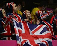 British fans cheer during the London 2012 Olympics Games. Team GB's haul of 65 medals, including 29 gold, was their best performance since London first hosted the Games in 1908, and their success has been seen as a major boost to the nation as a whole
