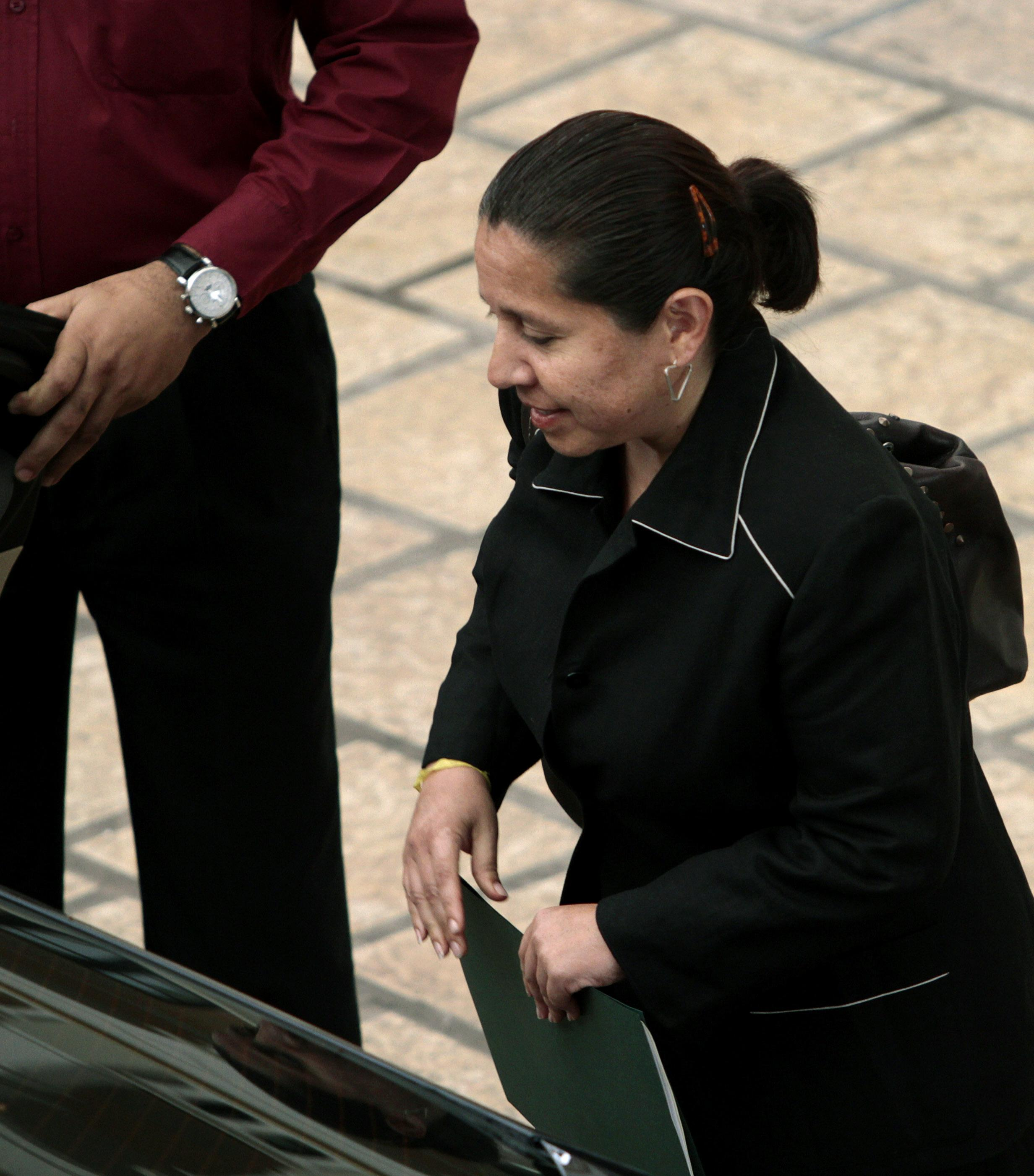 Fugitive ex-spy chief surrenders to Colombia