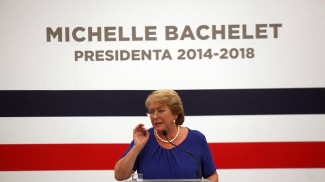Chile's President-elect Michelle Bachelet talks with journalist during a press conference in Santiago, Chile, Monday, Dec 16, 2013. Bachelet vowed to initiate profound changes after winning the seat by the biggest victory in eight decades. But analysts noted that the 41 percent voter turnout was the lowest since Chile's return to democracy, suggesting she'll need to move deliberately, not radically, when she begins her second turn in office next year. (AP Photo/Luis Hidalgo)