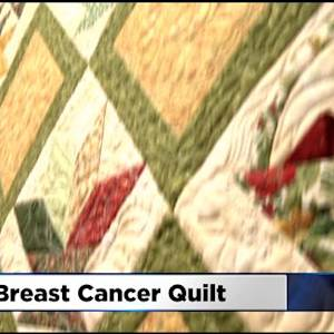 Sutter Cancer Center Holding Quilt Auction