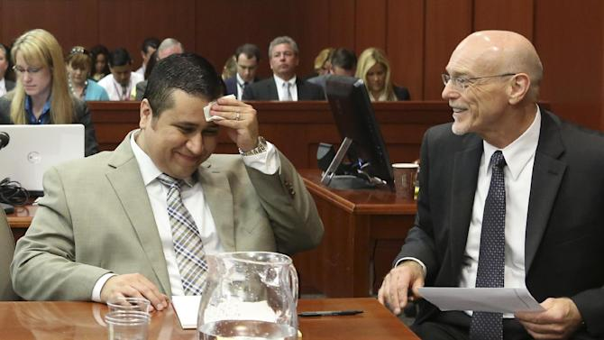George Zimmerman, left, laughs with his attorney Don West during his trial in Seminole County circuit court in Sanford, Fla. Tuesday, June 25, 2013. Zimmerman has been charged with second-degree murder for the 2012 shooting death of Trayvon Martin. (AP Photo/Orlando Sentinel, Gary W. Green, Pool)