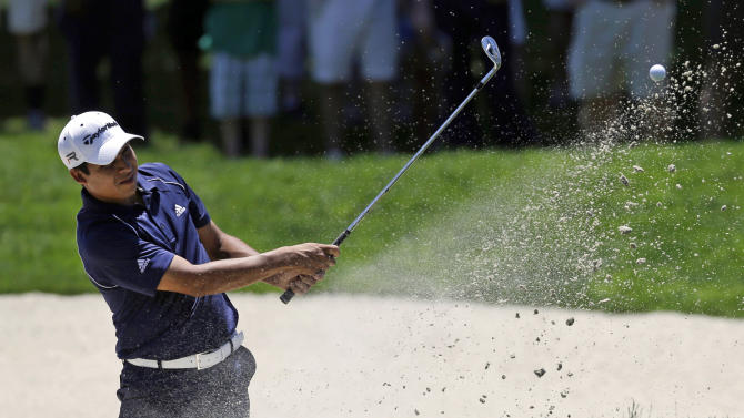 Andres Romero, of Argentina, chips onto the first green from a bunker during the third round of the AT&T National golf tournament at Congressional Country Club, Saturday, June 29, 2013, in Bethesda, Md. (AP Photo/Patrick Semansky)