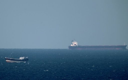 An oil tanker cruises towards the Strait of Hormuz off the shores of Khasab in Oman on January 15, 2012. Oman announced Wednesday a $33.54-billion budget for 2013, increasing spending by $7.5 billion over last year's forecasts, and keeping deficit at five percent of the gross domestic product. Public expenditure in the oil-producing sultanate in 2013 has been set at 12.9 billion rials