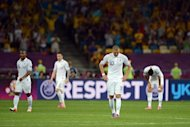 French forward Karim Benzema and team mates react after Sweden scored a second goal during the Euro 2012 football championships match Sweden vs France at the Olympic Stadium in Kiev. France qualified for the knockout stages of a major finals for the first time in six years here on Tuesday despite losing their final Euro 2012 Group D match 2-0 to already eliminated Sweden
