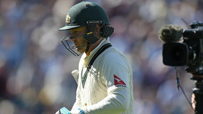 Australia's Michael Clarke walks back to the pavilion after being caught out by England's Adam Lyth for three runs on the second day of the third Ashes Test at Edgbaston on July 30, 2015