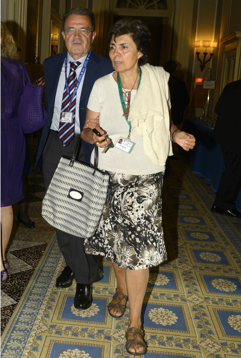Former Italian Premier Romano Prodi arrives with his wife Flavia for a meeting on World Economy in Cernobbio, Italy, Friday, Sept. 7, 2012. Experts and leaders gathered in Italy to discuss the prolong