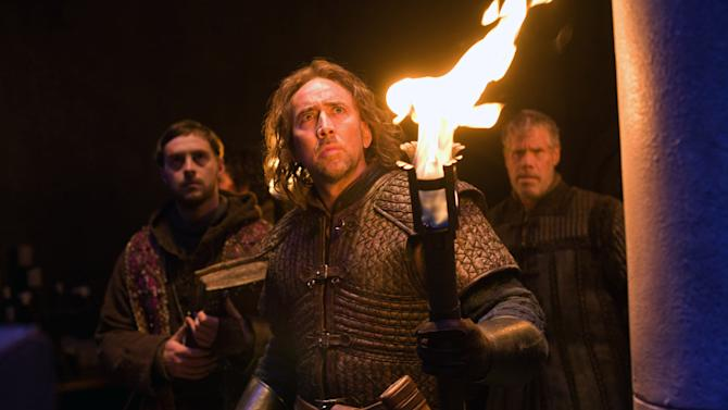 """In this film publicity image released by Relativity Media, from left, Stephen Campbell Moore, Nicolas Cage and Ron Perlman are shown in a scene from """"Season of the Witch."""" (AP Photo/Relativity Media, Egon Endrenyi)"""