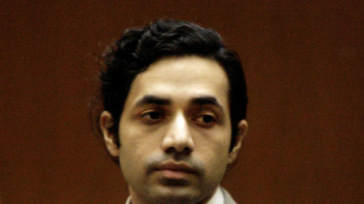 FILE- In this Nov. 13, 2008 file photo, fashion designer Anand Jon Alexander appears at his sexual assault trial in Los Angeles. Alexander has pleaded guilty in New York City to molesting a woman he baited with the promise of modeling work. Alexander admitted to one count of criminal sexual act Thursday. He was sentenced to five years in prison. He already was convicted in California of similar charges and was sentenced there to 59 years to life. Assistant District Attorney Maxine Rosenthal says he also is facing new charges in Texas.  (AP Photo/Nick Ut, File)