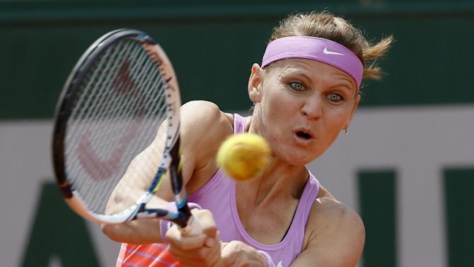 Czech Republic's Lucie Safarova hits a return to Spain's Garbine Muguruza during their women's quarter final match of the Roland Garros 2015 French Tennis Open in Paris on June 2, 2015