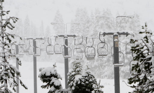Snow blankets the ski lift chairs at the Soda Springs Ski Resort near Soda Springs, Calif., Wednesday, Oct. 5, 2011. An early October storm swept through Northern California bringing rain to the lower levels and up to six inches of snow to the Sierra Nevada. (AP Photo/Rich Pedroncelli)