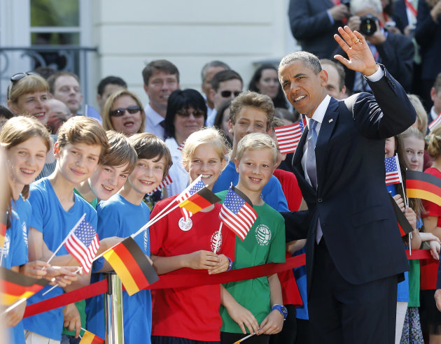 US President Barack Obama talks to children at the presidential residence Schloss Bellevue in Berlin, Germany, Wednesday, June 19, 2013. On the second day of his visit to Germany Obama is meeting with