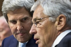 Secretary of State John Kerry, left, talks with Defense …