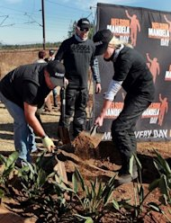 "South Africans plant trees at Howick as part of the ""Bikers For Mandela Day"" in July 2012. South Africa has unveiled its latest monument to Mandela, a new statue along a rural highway marking the spot where he was arrested 50 years ago for his struggle against apartheid"