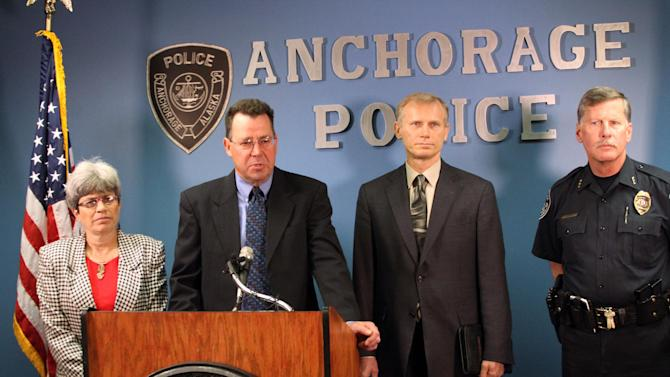 Assistant Alaska Attorney General John Novak speaks during a news conference Friday, June 20, 2014, in Anchorage, Alaska. Novak joined U.S. Attorney for Alaska Karen Loeffler, left; Anchorage Police Sgt. Slawomir Markiewicz, second from right, Anchorage Police Chief Mark Mew, right, and FBI Special Agent in Charge of the Anchorage office, Deirdre L. Fike, not pictured, in announcing authorities are investigating claims by convicted murder Joshua Wade that he is responsible for three additional deaths, for a total of five victims. (AP Photo/Mark Thiessen)