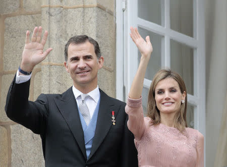 Spain's King Felipe VI and Queen Letizia wave during celebrations for St James' Day in Santiago de Compostela