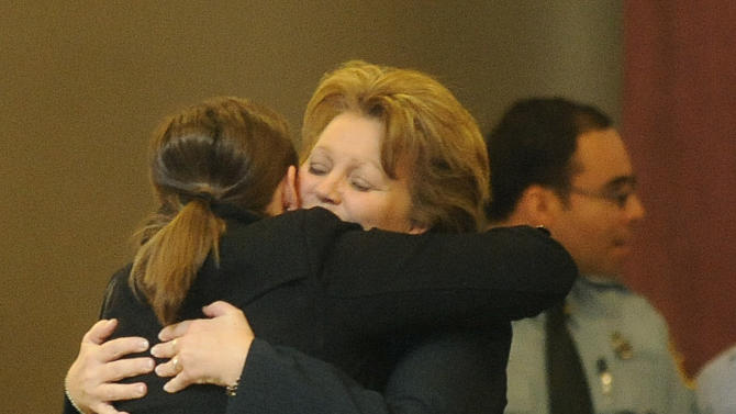Lisa Clements, the widow of Tom Clements got many supportive hugs after his memorial service for the chief executive of the Department of Corrections was held at New Life Church in Colorado Springs, Colo. on Monday, March 25, 2013. Tom Clements was shot and killed on the doorstep of his home last week in Monument, Colorado. (AP Photo/The Gazette, Jerilee Bennett, Pool)