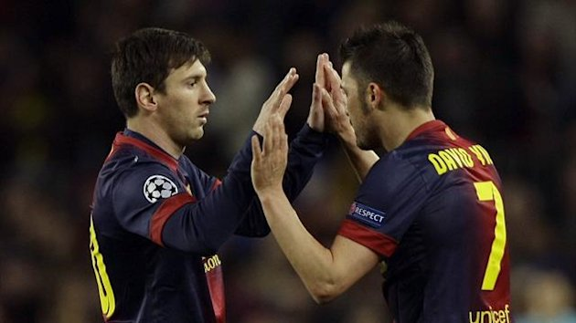 Barcelona's Lionel Messi (L) and David Villa (Reuters)