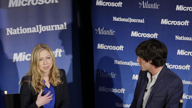 "Chelsea Clinton moderates a town-hall style meeting called ""Conversations With the Next Generation,"" as MTV's Andrew Jenks listens, Wednesday, Sept. 5, 2012, in Charlotte, N.C., during the second day of the Democratic National Convention. (AP Photo/Patrick Semansky)"