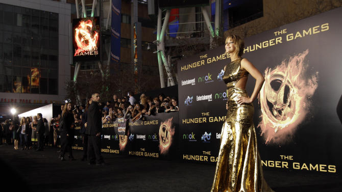 """FILE - In a Monday, March 12, 2012 file photo, cast member Jennifer Lawrence arrives at the world premiere of """"The Hunger Games"""" in Los Angeles. """"The Hunger Games"""" on Monday, April 30, 2012 was nominated for eight MTV Movie awards, including bids for best cast, breakthrough performance, and movie of the year. (AP Photo/Matt Sayles, File)"""