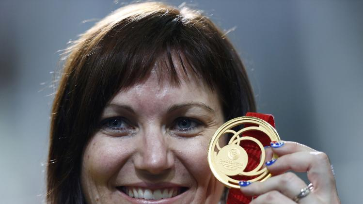 Australia's Anna Meares holds her gold medal after after winning the women's 500m time trial at the 2014 Commonwealth Games in Glasgow