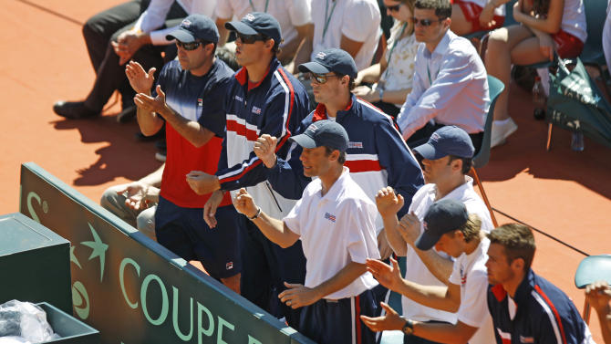 The U.S. team reacts during the match between France's Jo-Wilfried Tsonga and U.S. player John Isner, in the quarterfinal of the Davis Cup between France and U.S. in Monaco Sunday April 8, 2012. (AP Photo/Remy de la Mauviniere)