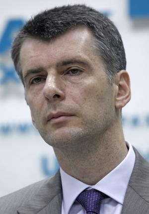 Russian tycoon Mikhail Prokhorov listens during his news conference  in Moscow, Russia, Thursday, Aug. 11, 2011. New Jersey Nets basketball team owner Mikhail Prokhorov who has recently been elected to lead a new Kremlin-friendly party says Russia needs to join the euro zone. (AP Photo/Mikhail Metzel)