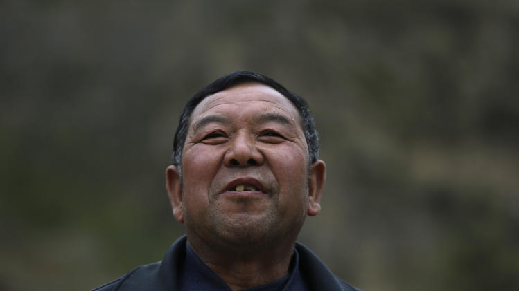 In this photo taken Thursday, Oct. 18, 2012, Shi Chunyang reminisces about his friendship with Chinese Vice President Xi Jinping who spent his youth learning peasant virtues at the Liangjiahe village in northwestern China's Shaanxi province. Xi, 59 and the country's vice president is expected to take over as head of the ruling party in November, 2012, before becoming president in 2013 of an increasingly assertive China. The Liangjiahe years are among scant details known about Xi's life and personality partly because he himself chronicled them as a key formative experience.  (AP Photo/Ng Han Guan)