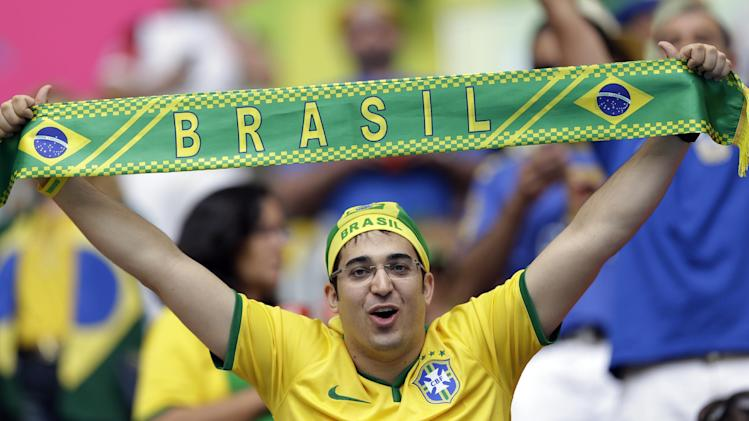 A Brazil fans cheers prior to the group A World Cup soccer match between Cameroon and Brazil at the Estadio Nacional in Brasilia, Brazil, Monday, June 23, 2014. (AP Photo/Andre Penner)