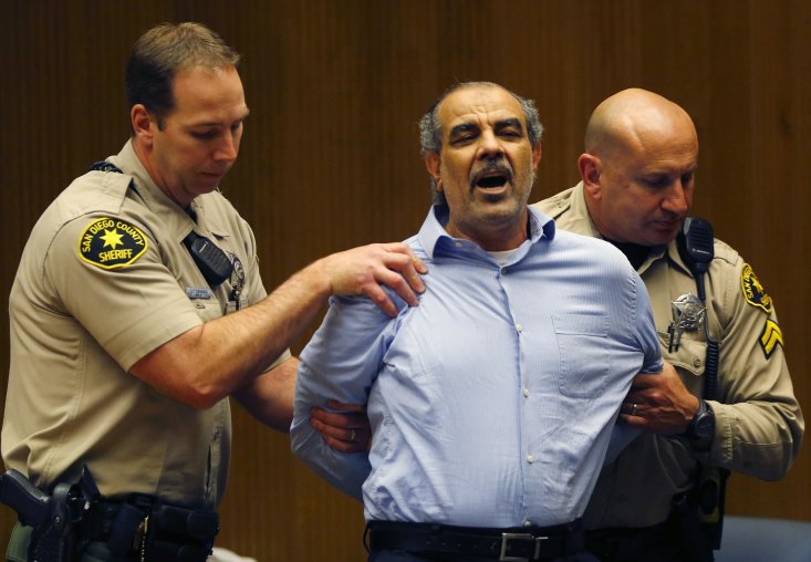 Court bailiffs restrain 49-year-old Kassim Alhimidi after a jury found him guilty of the first degree murder of his 32-year-old wife Shaima Alhimidi as the verdict was bought down in a courtroom at El Cajon, California April 17, 2014. The Iraqi-American man was found guilty by a San Diego jury on Thursday of bludgeoning his wife to death in their suburban home at El Cajon in a killing that was first investigated as a hate crime because of a threatening note found at the scene. El Cajon is in the heart of east San Diego County, which is home to the second-largest Iraqi community in the United States, behind Detroit. REUTERS/John Gastaldo/Pool (UNITED STATES - Tags: CRIME LAW)