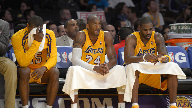 Los Angeles Lakers forward Metta World Peace, from left, guard Kobe Bryant and forward Antawn Jamison sit on the bench during the second half of their NBA basketball game against the Oklahoma City Thunder, Friday, Jan. 11, 2013, in Los Angeles. The Thunder won 116-101. (AP Photo/Mark J. Terrill)