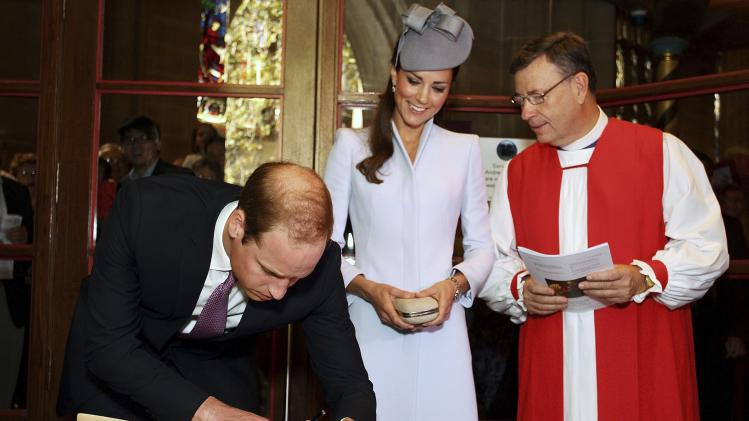 Britain's Prince William signs the First Fleet Bible following an Easter Sunday Service at St Andrews Cathedral in Sydney