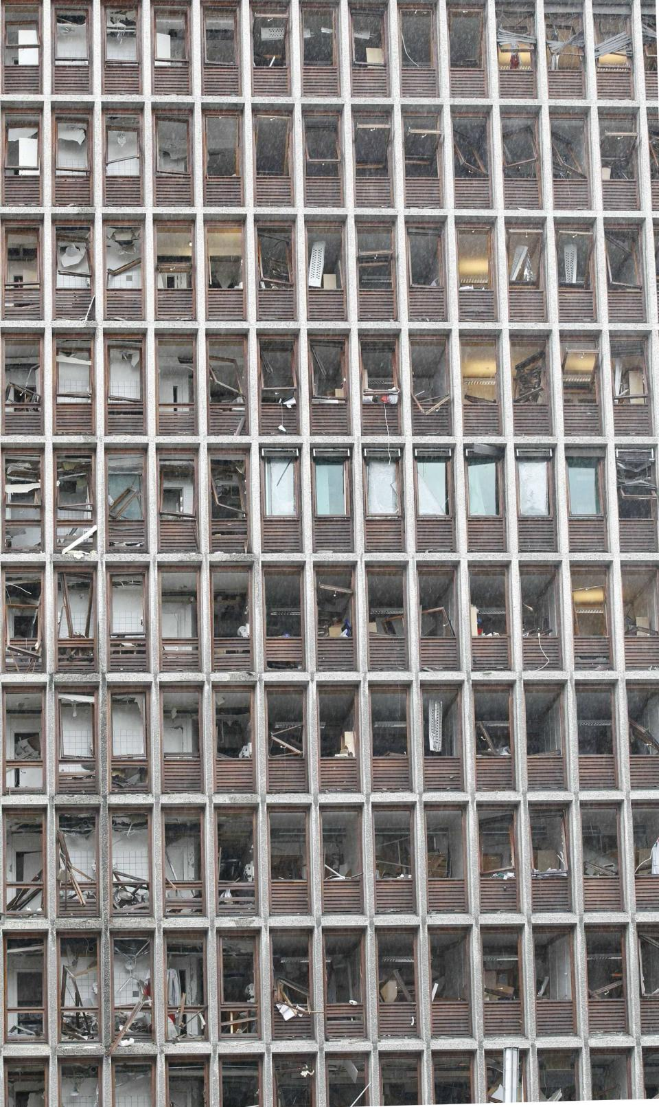 Damaged windows are seen on a building in central Oslo, Norway on Friday, July 22, 2011 after a bomb ripped open buildings in the heart of Norway's government. (AP Photo/Scanpix, Berit Roald)