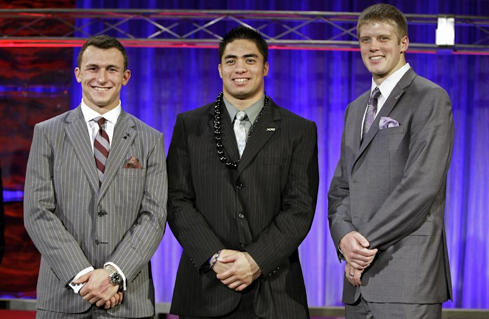 From left, Heisman Trophy candidates Texas A&M's Johnny Manziel, Notre Dame's Manti Te'o and Kansas State's Collin Klein pose for a photo at the Home Depot College Football Awards in Lake Buena Vista, Fla., Thursday, Dec. 6, 2012. (AP Photo/John Raoux)