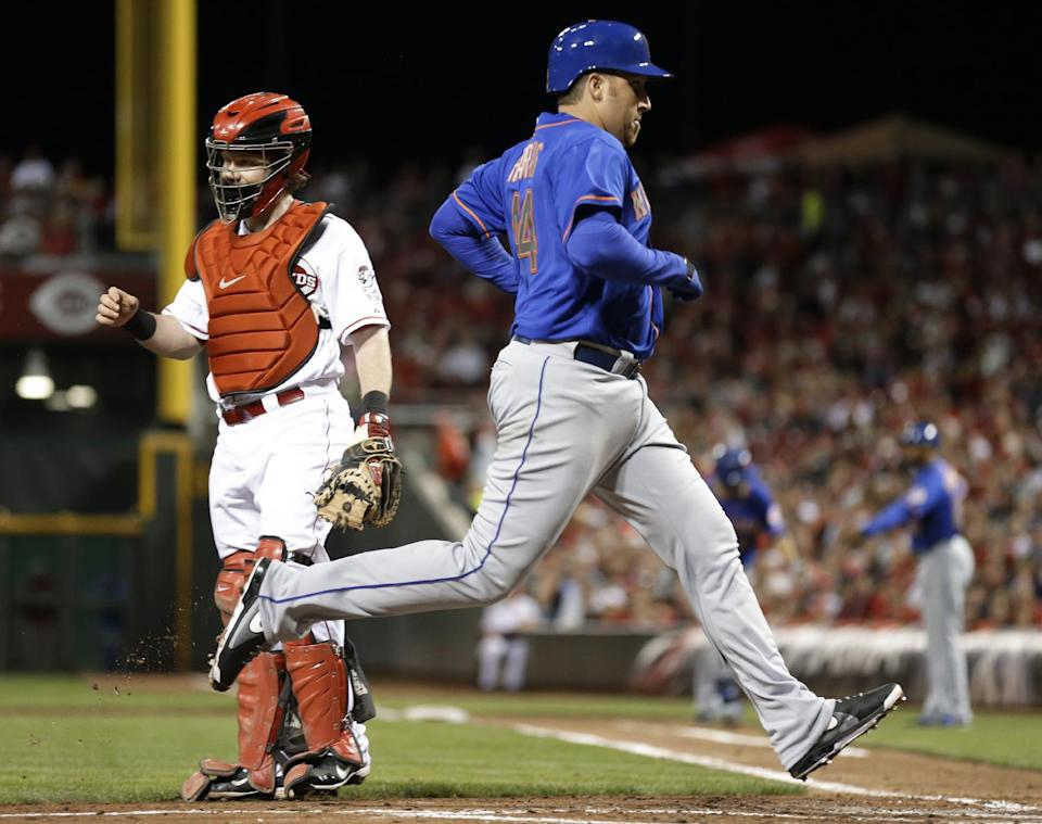 Reds clinch playoff berth, beat Mets 3-2 in 10th