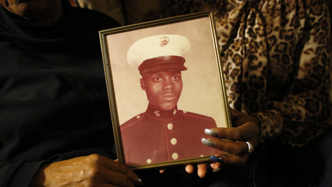 a picture of Jerome Murdough is held by his mother