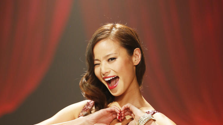 Jamie Chung walks the runway at the Red Dress Collection 2013 Fashion Show, on Wednesday, Feb. 6, 2013 in New York. (Photo by John Minchillo/Invision/AP)